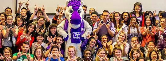 Students pose with Western mascot, JW